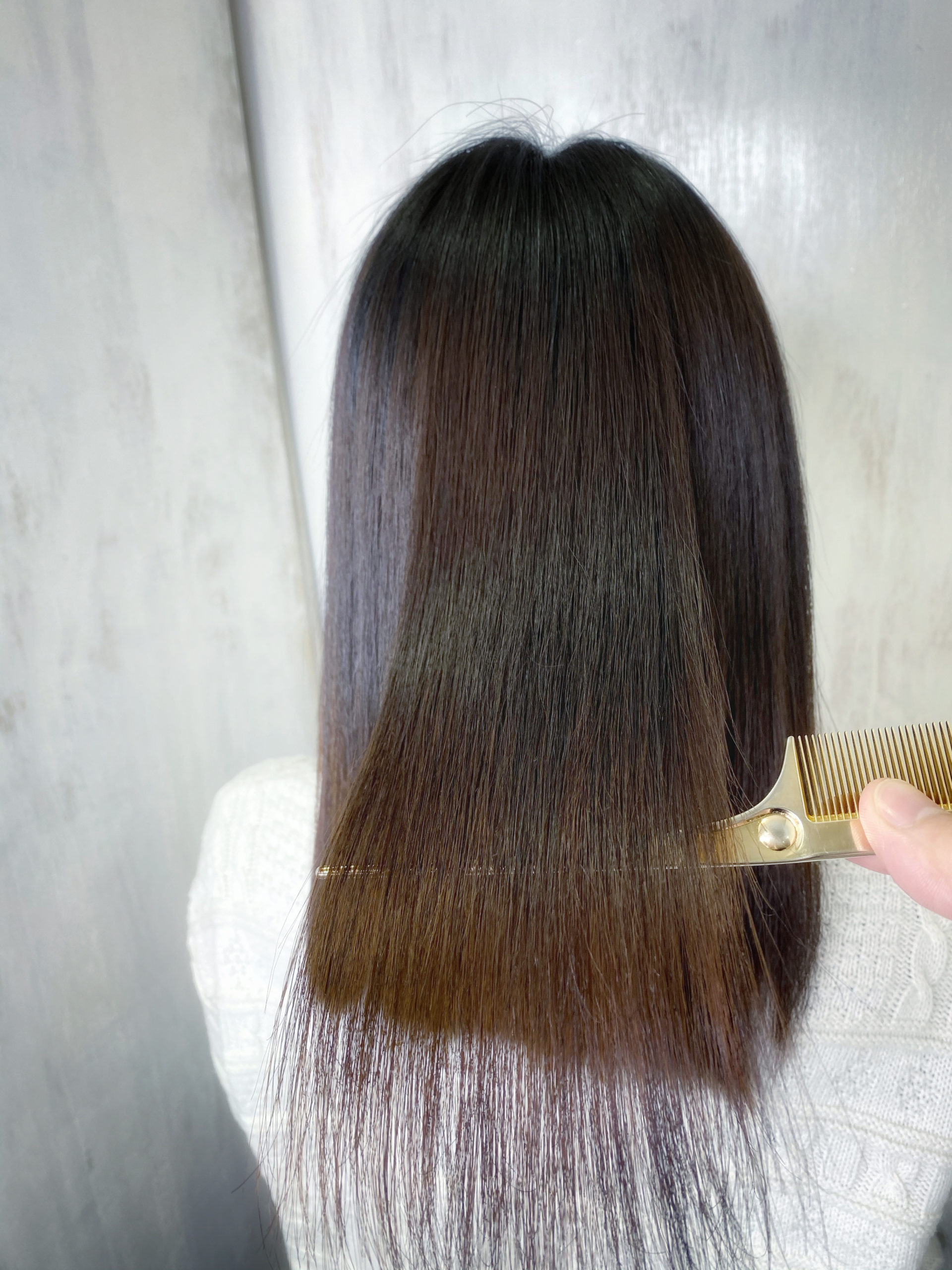 ブリーチとスパイラルパーマをしている髪を【ビビリ矯正】で艶髪。原宿・表参道『髪のお悩みを解決するヘアケア美容師の挑戦』